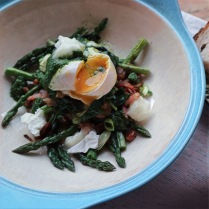 Sauteed asparagus and spinach with goats cheese and poached egg topped with nettle pesto