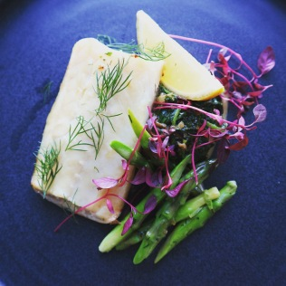 Smoked haddock fillet on herby creamed spinach, sauteed asparagus and amaranth